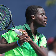 Francis Tiafoe, USA, in action during his astonishing win over number one seed Andrey Rublev, Russia, in the Junior Boys' Singles Quarterfinals. Tiafoe blew a 6-1, 5-1 lead to win the third set 6-4 in sweltering heat during the US Open Tennis Tournament, Flushing, New York, USA. 5th September 2014. Photo Tim Clayton