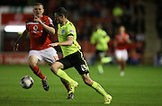 Brighton winger, Jamie Murphy breaks forward during the Capital One Cup match between Walsall and Brighton and Hove Albion at the Banks's Stadium, Walsall, England on 25 August 2015.