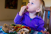 21 month girl eating lunch off a plate, Caloundra, Queensland, Australia