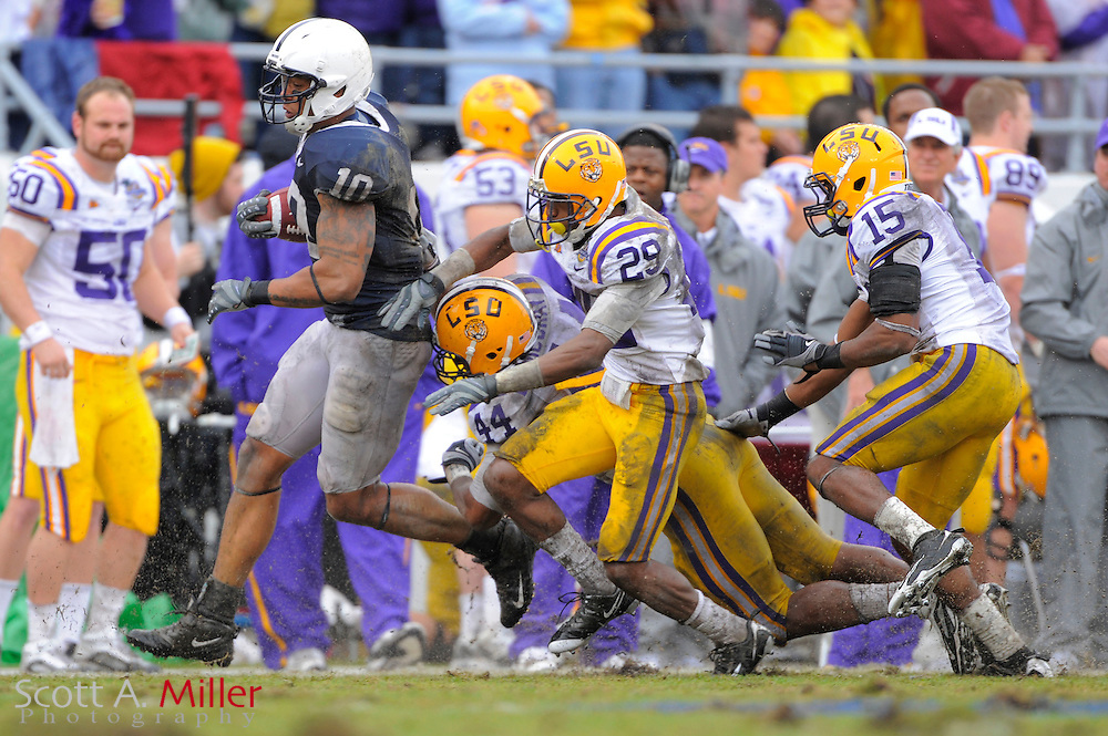 Jan. 1, 2010; Orlando, FL, USA; Penn State Nittany Lions tight end Andrew Quarless (10) is chased out of bounds by LSU Tigers safety Danny McCray (44), cornerback Chris Hawkins (29) and cornerback Brandon Taylor (15) during the Nittany Lions 19-17 win over the LSU Tigers in the 2009 Capital One Bowl at the Citrus Bowl. ©2010 Scott A. Miller
