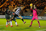 Jonathan Stead (30) of Notts County is unable to get on the end of a cross which is claimed by Luke McCormick (23) of Plymouth Argyle during the EFL Sky Bet League 2 match between Plymouth Argyle and Notts County at Home Park, Plymouth, England on 28 February 2017. Photo by Graham Hunt.