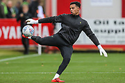 Forest Green Rovers goalkeeper Joe Wollacott(13), on loan from Bristol City warming up during the EFL Sky Bet League 2 match between Cheltenham Town and Forest Green Rovers at Jonny Rocks Stadium, Cheltenham, England on 2 November 2019.