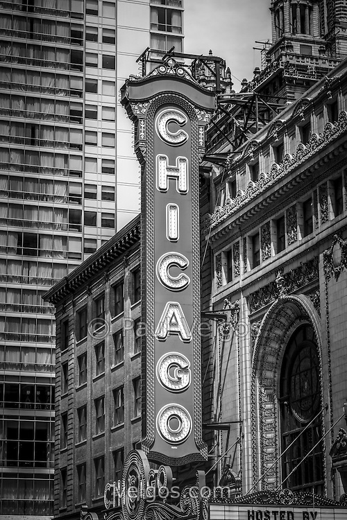 Chicago Theater sign in black and white. The Chicago Theatre is a popular venue for concerts and stage performances and is a landmark listed with the National Register of Historic Places.
