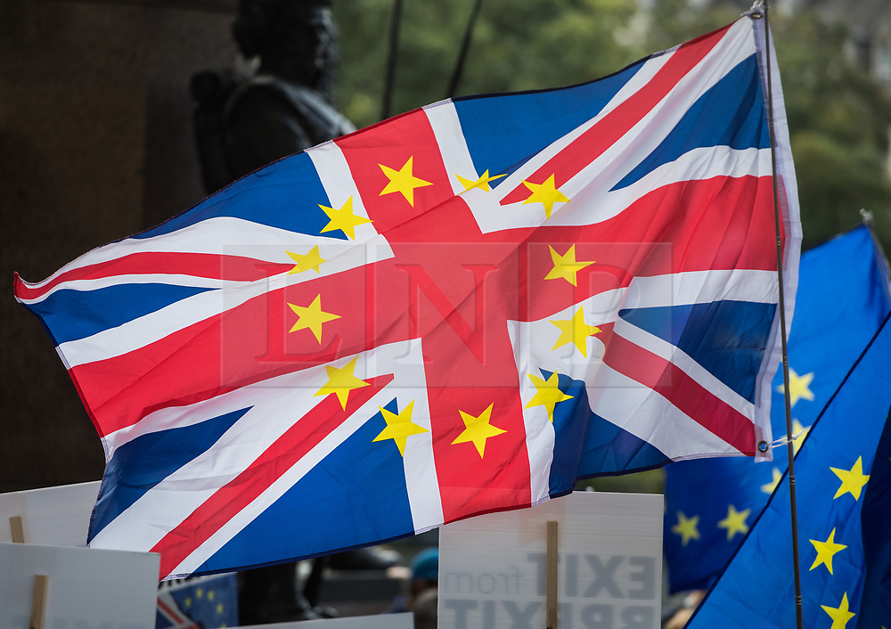 © Licensed to London News Pictures. 09/09/2017. London, UK. A conjoined EU and Union flag is held aloft on the pro EU People's March For Europe in central London. Speakers including Sir Bob Geldof, Sir Ed Davey and Liberal Democrat leader Vince Cable will address a rally in Parliament Square. Photo credit: Peter Macdiarmid/LNP