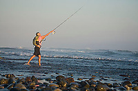Young woman fishing on beach on the Pacific Coast. Mexico.