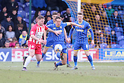 Paul Robinson of AFC Wimbledon and Billy Kee of Accrington Stanley FC tussle during the Sky Bet League 2 match between AFC Wimbledon and Accrington Stanley at the Cherry Red Records Stadium, Kingston, England on 5 March 2016. Photo by Stuart Butcher.