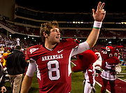 Nov 12, 2011; Fayetteville, AR, USA;  Arkansas Razorbacks quarterback Tyler Wilson (8) gestures toward the crowd following a game against the Tennessee Volunteers at Donald W. Reynolds Razorback Stadium. Arkansas defeated Tennessee 49-7. Mandatory Credit: Beth Hall-US PRESSWIRE