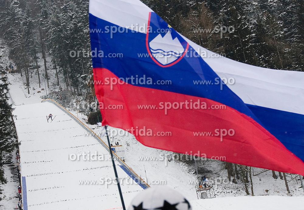 Slovenian national flag and a lady ski jumper during Normal Hill Individual Competition at FIS World Cup Ski jumping Ladies Ljubno 2012, on February 12, 2012 in Ljubno ob Savinji, Slovenia. (Photo By Grega Valancic / Sportida.com)