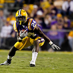 November 13, 2010; Baton Rouge, LA, USA; LSU Tigers running back Alfred Blue (24) runs with the ball during the second half against the Louisiana Monroe Warhawks at Tiger Stadium. LSU defeated Louisiana-Monroe 51-0.  Mandatory Credit: Derick E. Hingle