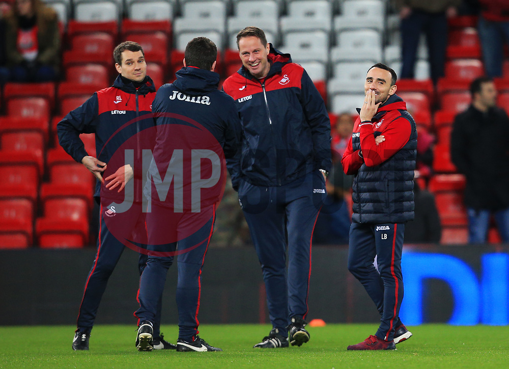 Swansea City caretaker manager Leon Britton shares a joke with his coaching staff before kick off - Mandatory by-line: Matt McNulty/JMP - 26/12/2017 - FOOTBALL - Anfield - Liverpool, England - Liverpool v Swansea City - Premier League