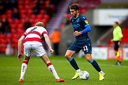 Luke Leahy of Bristol Rovers takes on Brad Halliday of Doncaster Rovers - Mandatory by-line: Robbie Stephenson/JMP - 19/10/2019 - FOOTBALL - The Keepmoat Stadium - Doncaster, England - Doncaster Rovers v Bristol Rovers - Sky Bet League One