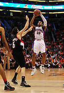 Apr 26, 2010; Phoenix, AZ, USA; Phoenix Suns guard Leandro Barbosa (10) puts up a shot against Portland Trailblazers guard Rudy Fernandez (5) during the second quarter in game five in the first round of the 2010 NBA playoffs at the US Airways Arena.  Mandatory Credit: Jennifer Stewart-US PRESSWIRE