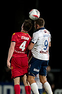 GOSFORD, AUSTRALIA - OCTOBER 02: Adelaide United midfielder Ryan Strain (4) and Central Coast Mariners forward Jordan Murray (9) go up for the ball during the FFA Cup Semi-final football match between Central Coast Mariners and Adelaide United on October 02, 2019 at Central Coast Stadium in Gosford, Australia. (Photo by Speed Media/Icon Sportswire)