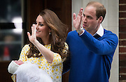 UNITED KINGDOM, London: 2 May 2015 Prince William, Duke of Cambridge and Catherine, Duchess of Cambridge stand on the steps of the  Lindo Wing  and pose for media and fans to show Princess Charlotte, for the first time at St Marys Hospital in London, England.  Andrew Cowie / Story Picture Agency