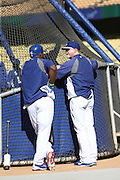 LOS ANGELES, CA - MAY 28:  Yasiel Puig #66 of the Los Angeles Dodgers talks to Hitting Coach Mark McGwire #25 of the Los Angeles Dodgers during batting practice before the game against the Cincinnati Reds at Dodger Stadium on Wednesday, May 28, 2014 in Los Angeles, California. The Reds won the game 3-2. (Photo by Paul Spinelli/MLB Photos via Getty Images) *** Local Caption *** Yasiel Puig;Mark McGwire