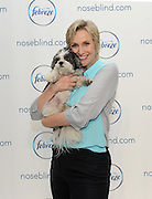 Emmy award-winning actress Jane Lynch holds dog Baby Hope at a Febreze event to shed light on a little known condition: noseblindness and to encourage dialogue about what your guests really smell, Wednesday, July 9, 2014, in New York.  Check out her Funny or Die video on the topic at noseblind.com.  (Photo by Diane Bondareff/Invision for Febreze/AP Images)