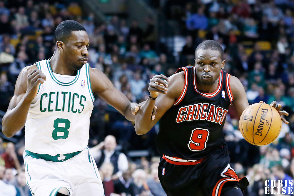 18 January 2013: Chicago Bulls small forward Luol Deng (9) drives pat Boston Celtics power forward Jeff Green (8) during the Chicago Bulls 100-99 overtime victory over the Boston Celtics at the TD Garden, Boston, Massachusetts, USA.