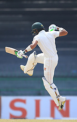 July 17, 2017 - Colombo, Sri Lanka - Zimbabwe cricketer Sikandar Raza leaps in the air in celebration after scoring 100 runs during the 4th day's play in the only Test match between Sri Lanka and Zimbabwe at ..R Premadasa International Cricket Stadium in the capital city of Colombo, Sri Lanka on Monday  17th July 2017  (Credit Image: © Tharaka Basnayaka/NurPhoto via ZUMA Press)