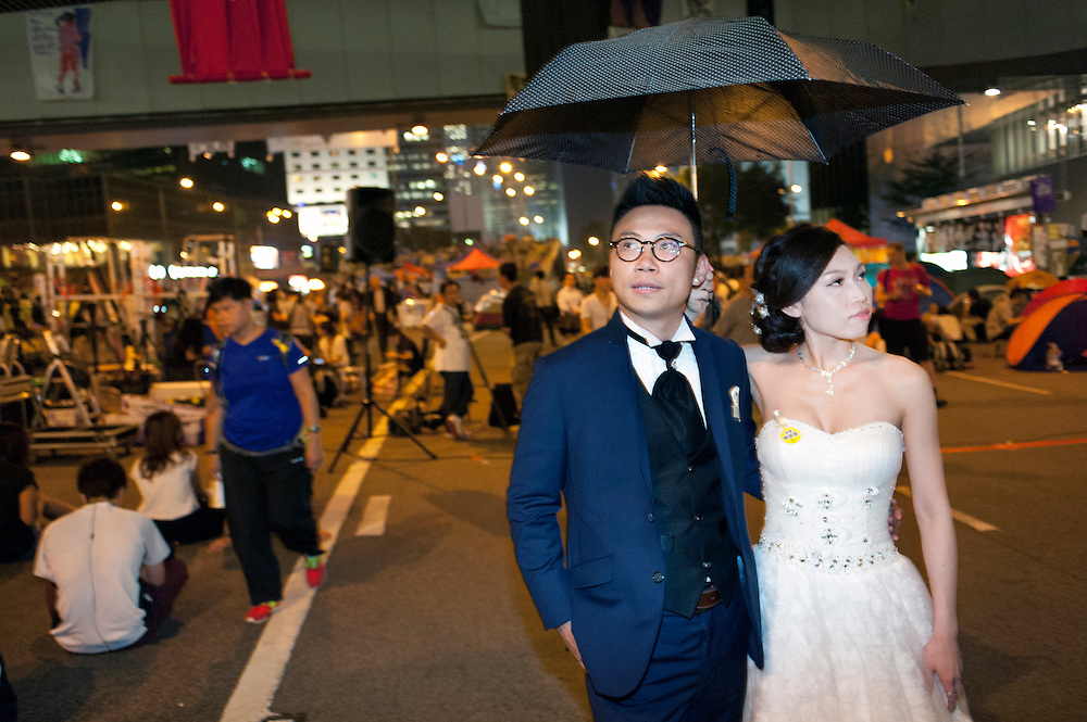 Occupied sites are popular among HK visitors and new married couples posing here for a photographer<br /> <br /> Hong Kong's democracy protest in Admiralty