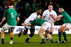 Emmanuel Iyogun of England U20 is tackled by John McKee of Ireland U20 - Rogan/JMP - 21/02/2020 - Franklin's Gardens - Northampton, England - England U20 v Ireland U20 - Under 20 Six Nations.