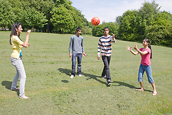 Group of friends playing with a ball in the park,
