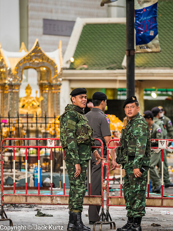 18 AUGUST 2015 - BANGKOK, THAILAND: Thai soldiers and police at Erawan Shrine Tuesday morning. An explosion at Erawan Shrine, a popular tourist attraction and important religious shrine in the heart of the Bangkok shopping district killed at least 20 people and injured more than 120 others, including foreign tourists, during the Monday evening rush hour. Twelve of the dead were killed at the scene. Thai police said an Improvised Explosive Device (IED) was detonated at 18.55. Police said the bomb was made of more than six pounds of explosives stuffed in a pipe and wrapped with white cloth. Its destructive radius was estimated at 100 meters.    PHOTO BY JACK KURTZ