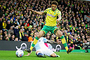 Norwich City defender Jamal Lewis (12) rides this challenge during the EFL Sky Bet Championship match between Norwich City and Blackburn Rovers at Carrow Road, Norwich, England on 27 April 2019.