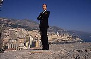 HRH Albert of Monaco, on the palace fortifications     Monaco     S.A.S. Albert de Monaco sur les remaprts du palais avec la ville et la riviera en arriere plan    Monaco   288286/66    L0006107  /  P0003699