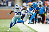 Sunday, Oct. 27, 2013, Detroit Lions wide receiver Kris Durham (18) is forced out of bounds by Dallas Cowboys safety Jakar Hamilton (23) after he makes a forty yard reception in the fourth quarter in Detroit. Detroit won 31-30. (AP Photo/Rick Osentoski)