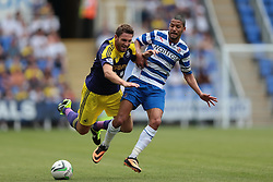 Swansea City defender Angel Rangel (22) is challenged by Reading midfielder Jobi McAnuff (11) during the pre-season friendly game between Reading and Swansea City.  Photo mandatory by-line: Nigel Pitts-Drake/JMP  - Tel: Mobile:07966 386802 27/07/2013 - Reading v  Swansea City  - SPORT - FOOTBALL - pre-season - Reading - Madejski Stadium