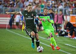 SANTA CLARA, USA - Saturday, July 30, 2016: Liverpool's Alberto Moreno in action against AC Milan's Ignazio Abate during the International Champions Cup 2016 game on day ten of the club's USA Pre-season Tour at the Levi's Stadium. (Pic by David Rawcliffe/Propaganda)