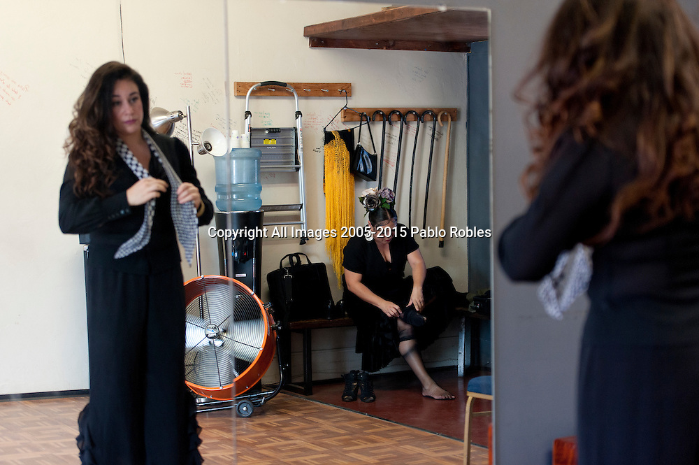 Singer Olivia Rojas (left) and Flamenco dancer Angelina Ramirez (right) prepare for a demonstration in their dance studio in Downtown Phoenix on August 12, 2016. Rojas and Ramirez are co-owners of Flamenco Por La Vida dance studio. Singer Olivia Rojas and Flamenco dancer Angelina Ramirez co-owners of Flamenco Por La Vida dance studio in Downtown Phoenix, AZ.