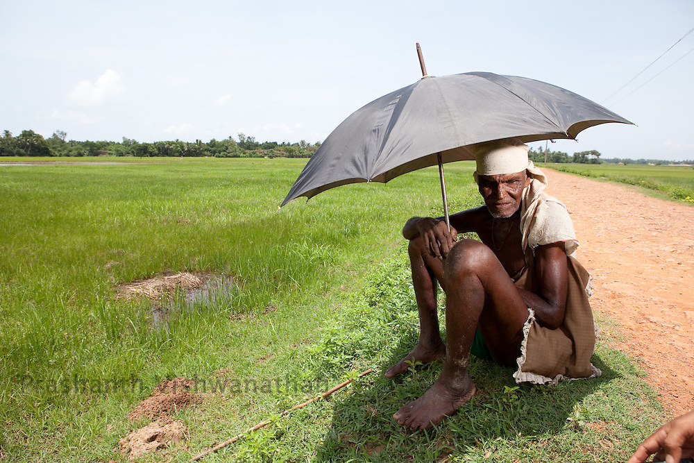 75 years old, Makar Khandi, speaks to the reporter,  as he looks over his fields inside the proposed plot alloted to POSCO steel company in Dinkia, Orissa, India, on Thursday July 1, 2010. Photographer: Prashanth Vishwanathan/Bloomberg News