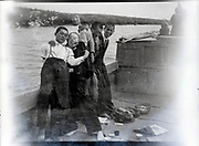 double exposed negative with young boys having fun a o river boat Japan ca 1950s