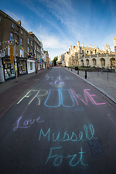 Image ©Licensed to i-Images Picture Agency. 07/07/2014. Cambridge, United Kingdom. Tour de France Stage 3 Cambridge. Writing on the road outside Kings College Cambridge. Picture by Terry Harris / i-Images