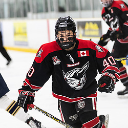 TORONTO, ON - APR 10, 2018: Ontario Junior Hockey League, South West Conference Championship Series. Game seven of the best of seven series between the Georgetown Raiders and the Toronto Patriots, Jaden Condotta #40 of the Georgetown Raiders follows the play during the second period.<br /> (Photo by Kevin Raposo / OJHL Images)