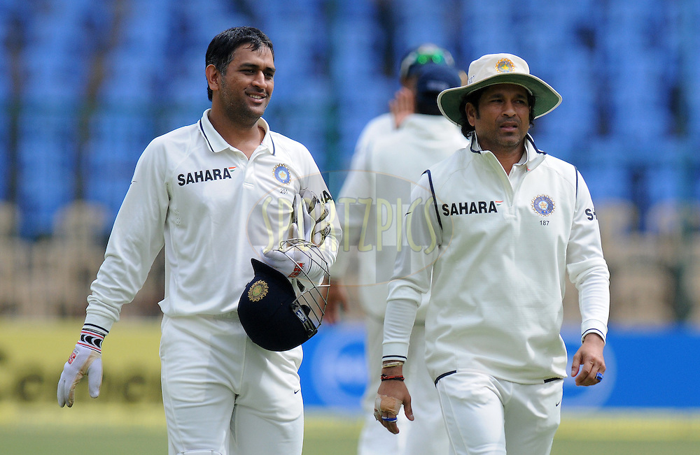 Mahendra Singh Dhoni captain of India and Sachin Tendulkar of India walk back to the pavilion during day two of the second test match between India and New Zealand held at the M. Chinnaswamy Stadium, Bengaluru on the 1st September 2012..Photo by Pal Pillai/BCCI/SPORTZPICS