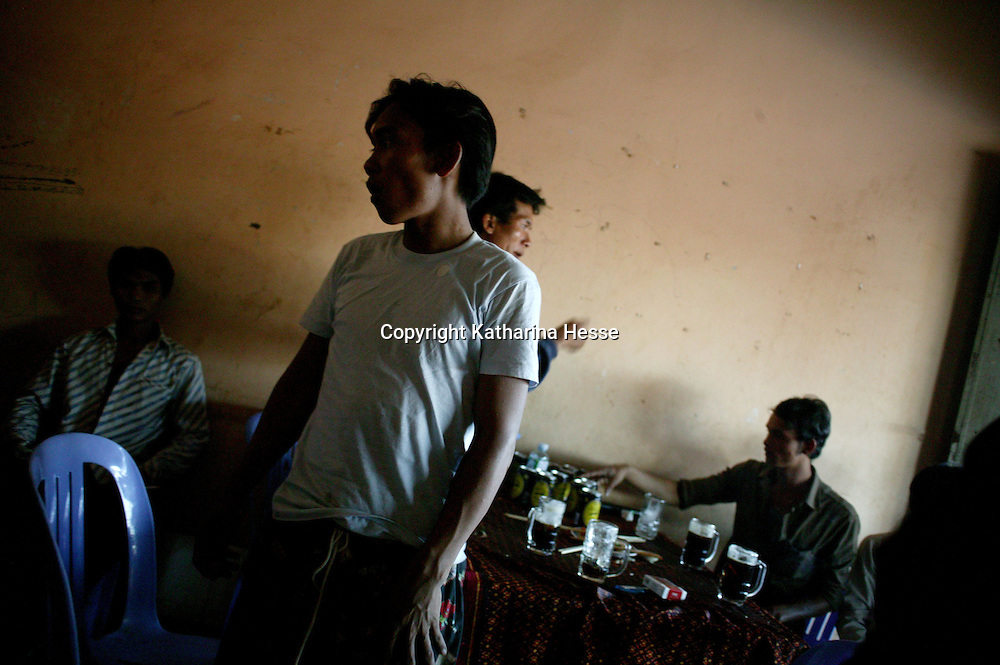 SIEM REAP, NOVEMBER-28: young men drink in the afternoon in a restaurant in Siem Reap, November 28, 2006, Cambodia. ..