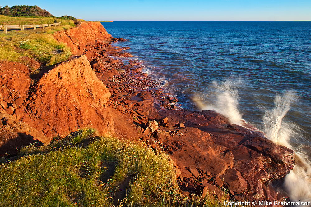 Sandy shoreline and red bluffs along the Northumberland Strait<br />East Point<br />Prince Edward Island<br />Canada
