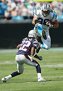 CHARLOTTE, NC - SEPTEMBER 18:  Tight end Kris Mangum #86 of the Carolina Panthers tries to leap over cornerback Asante Samuel #22 of the New England Patriots after a pass reception at Bank of America Stadium on September 18, 2005 in Charlotte, North Carolina. The Panthers defeated the Patriots 27-17. ©Paul Anthony Spinelli *** Local Caption *** Kris Mangum;Asante Samuel