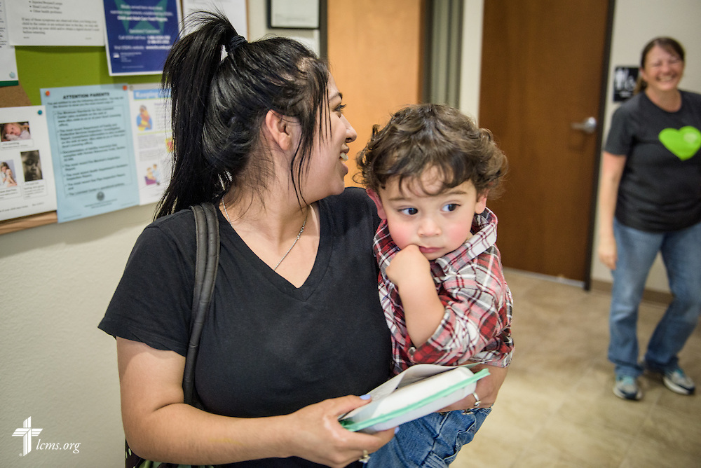 Xavier and his mother leave ACTS of Love Early Childhood Education Center on Tuesday, Nov. 15, 2016, in Leander, Texas. Teacher and caregiver Laurie Harkey smiles as the two depart.  LCMS Communications/Erik M. Lunsford