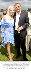 MR & MRS SEBASTIAN VAN DAM she was Clare Beckwith, at a polo match in West Sussex on 21st July 2002.PCE 97
