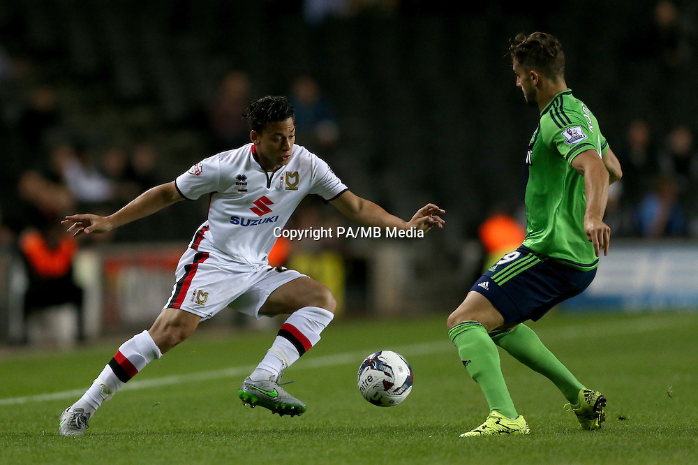 Milton Keynes Dons' Cristian Benavente (left) and Southampton's Jay Rodriguez battle for the ball during the Capital One Cup, third round match at Stadium:MK, Milton Keynes.