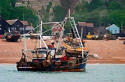 UK ENGLAND HASTINGS 6JUL06 - View of the Hastings-registered RX76 launching from Hastings Stade. Hastings Stade is home to Britain's biggest fleet of beach-launched fishing boats with a history dating back more than a thousand years. The boats have to be hauled out of the sea after each trip, which stops them being more than about ten metres long. This means that they can only carry small amounts of gear and travel just a few miles. As a result the fleet has always fished in an ecologically sound way.  ..jre/Photo by Jiri Rezac / WWF UK..© Jiri Rezac 2006..Contact: +44 (0) 7050 110 417.Mobile:  +44 (0) 7801 337 683.Office:  +44 (0) 20 8968 9635..Email:   jiri@jirirezac.com.Web:    www.jirirezac.com..© All images Jiri Rezac 2006 - All rights reserved.