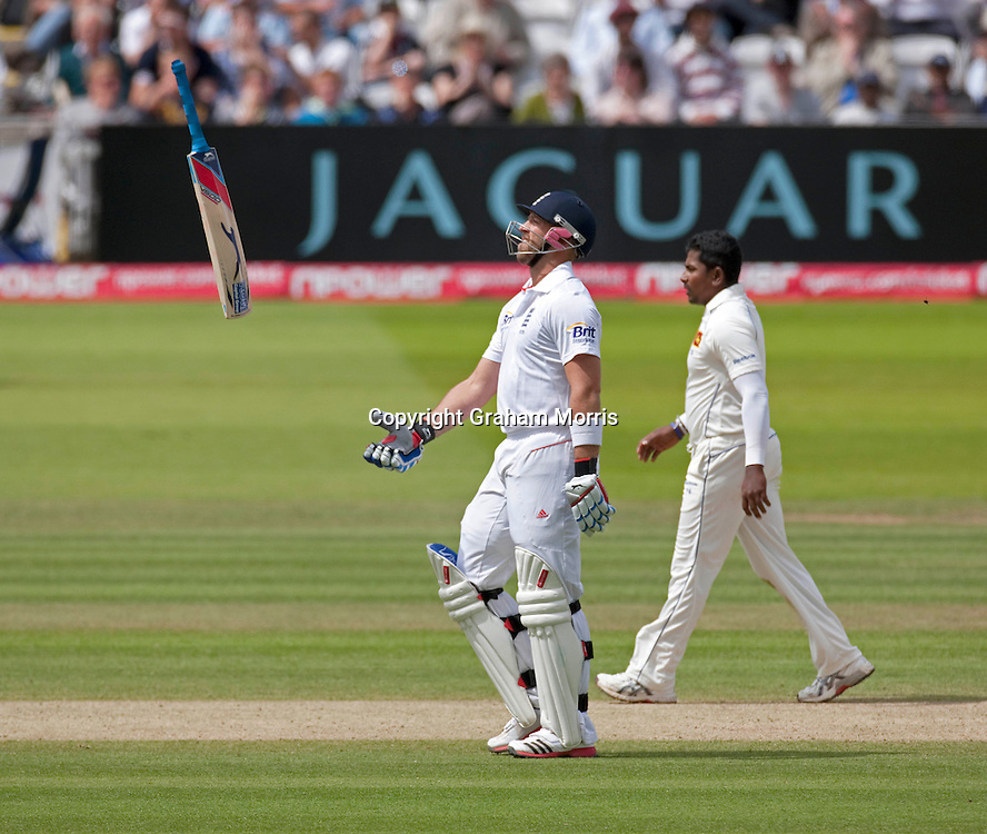 Bowler Rangana Herath walks behind as Matt Prior throws his bat in the air after being run out for four during the second npower Test Match between England and Sri Lanka at Lord's.  Photo: Graham Morris (Tel: +44(0)20 8969 4192 Email: sales@cricketpix.com) 07/06/11