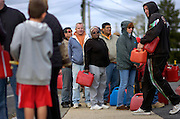 People wait in the long line to fill up their gas cans at the Gulf gas station on Route 35 North and 5th Avenue in Neptune two days after Hurricane Sandy made it's way through the area on October 31. Hurricane Sandy forced the shutdown of mass transit, schools and financial markets, sending coastal residents fleeing for higher ground, and threatened a dangerous mix of high winds and soaking rain.