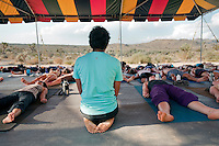 Bhakti Fest 2011Pradeep Teotia yoga teacher watching over his student during savasana in yoga studio 3 which had a beautiful view of the desert. Bhakti Fest is a Yoga | Dance | Music Festival which celebrates the devotional path that has its roots in yoga, kirtan, and meditation. It embraces ancient and modern sacred wisdom and traditional and non-traditional spiritual practices. The festival is a vehicle for evolution of human consciousness through a heart-centered revolution.