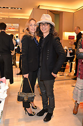 JEANNE MARINE and leading hairdresser MASSATO at a breakfast at Roger Vivier, 188 Sloane Street to view the SS2014 Roger Vivier collections held on 20th March 2014.