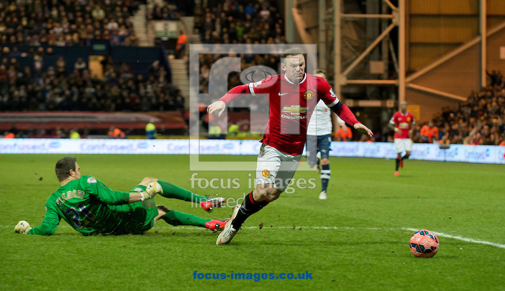 Preston North End goalkeeper Thorsten Stuckmann brings down Wayne Rooney of Manchester United to concede a penalty during the FA Cup match at Deepdale, Preston<br /> Picture by Russell Hart/Focus Images Ltd 07791 688 420<br /> 16/02/2015