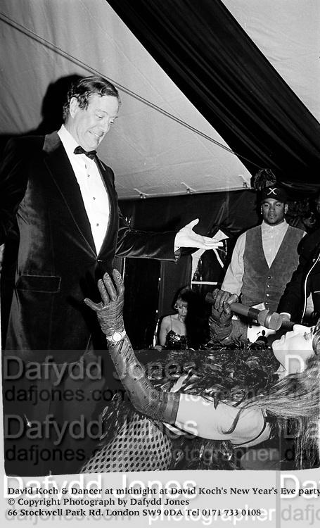 David Koch & Dancer at midnight at David Koch's New Year's Eve party. Aspen. 1994.<br />© Copyright Photograph by Dafydd Jones<br />66 Stockwell Park Rd. London SW9 0DA<br />Tel 0171 733 0108